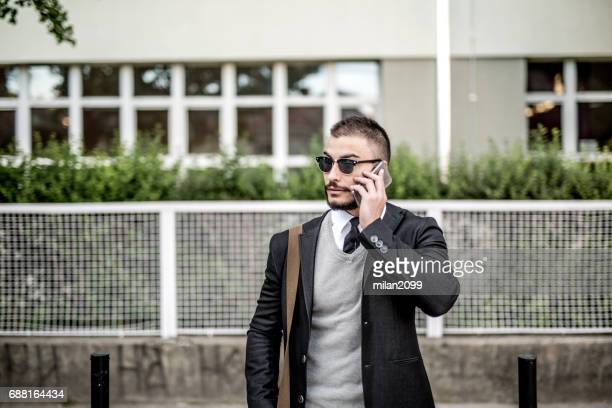 talking over the phone - milan2099 stock photos and pictures