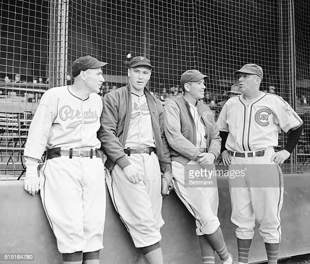 Talking things over before their exhibition game at Wrigley Field March 18 are four eminent gentlemen of the Pittsburgh Pirates and Chicago Cubs...