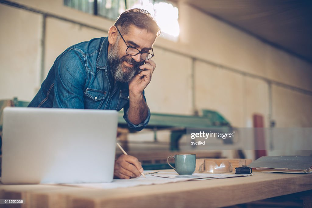 Talking to a client. : Stockfoto