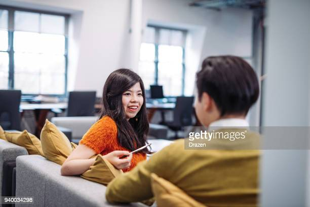 talking to colleagues during work hours - work romance stock pictures, royalty-free photos & images
