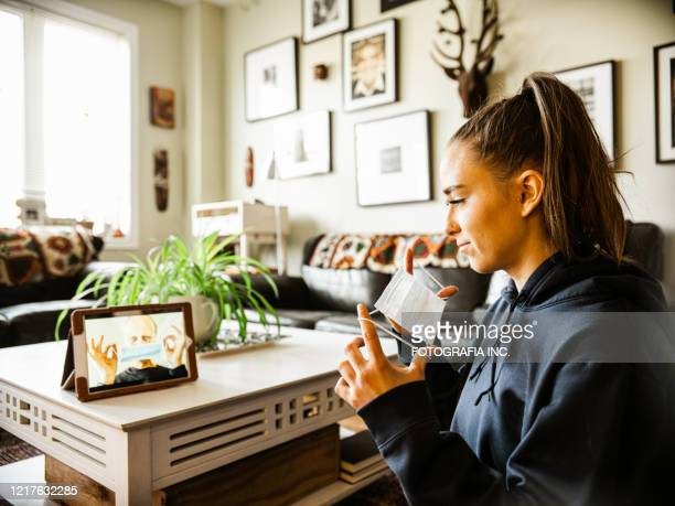 covid-19, talking to grandpa during lockdown - illness prevention stock pictures, royalty-free photos & images
