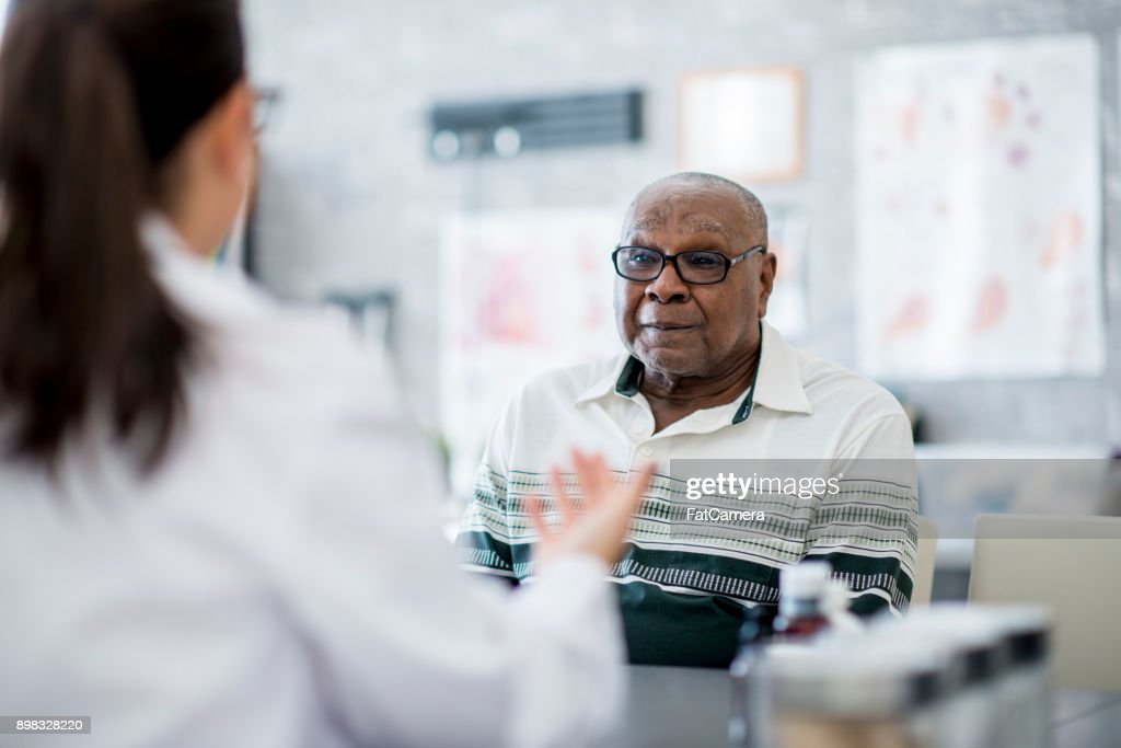 Talking To His Doctor : Stock Photo