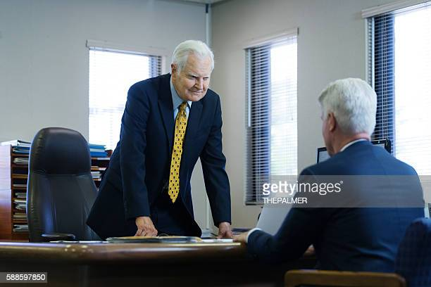 CEO talking to one of his employees