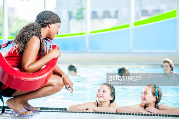 talking to the lifeguard - leisure facilities stock pictures, royalty-free photos & images
