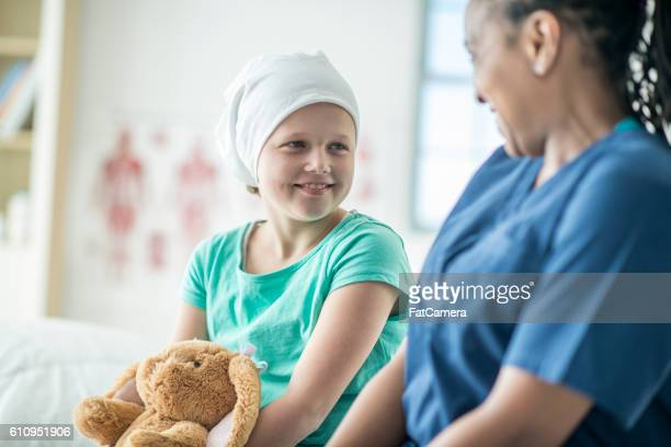 talking with a cancer patient - cancer stock photos and pictures