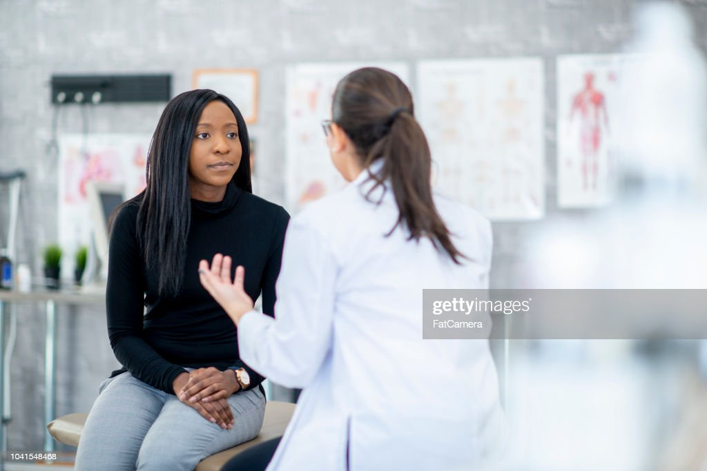 Talking With A Patient : Stock Photo