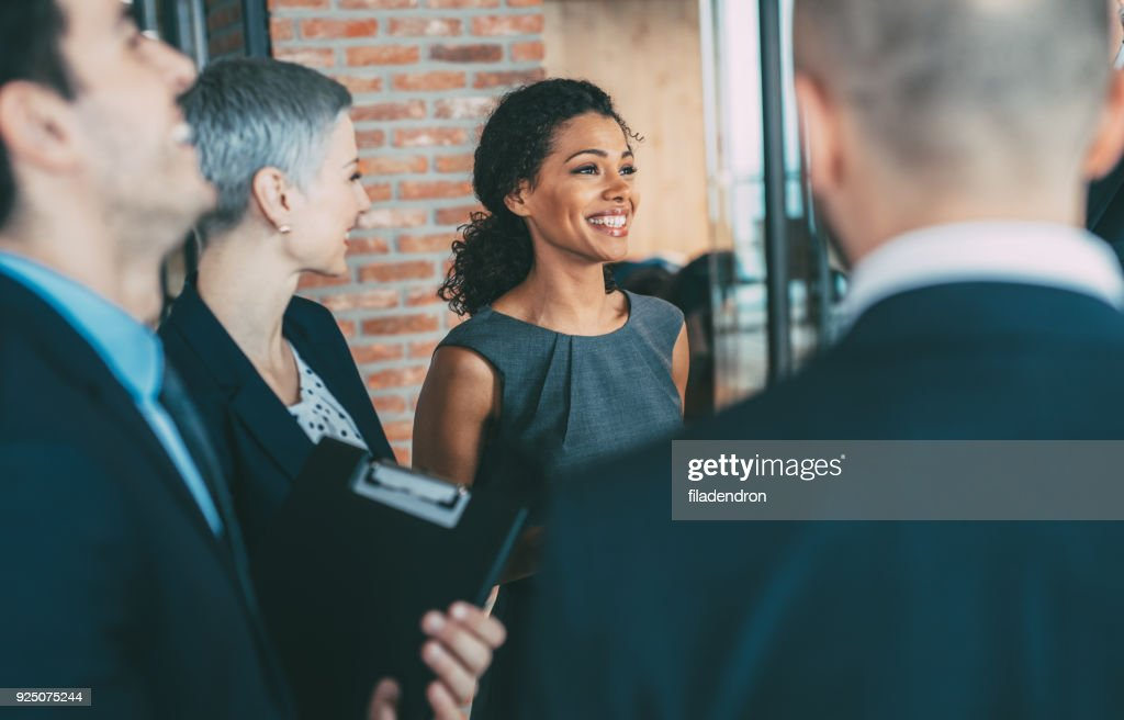 Talking with the colleagues : Stock Photo