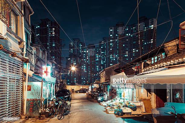 tall and low residential building - slum stock pictures, royalty-free photos & images