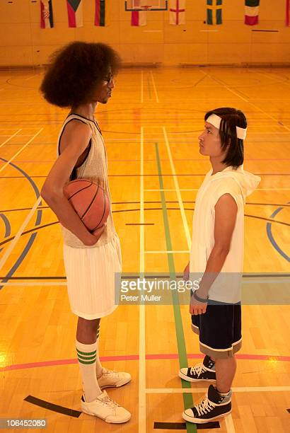 tall and short basketball players - tall high stock photos and pictures