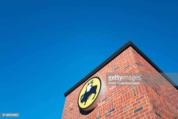 Tall brick structure with logo for the Buffalo Wild Wings restaurant chain in downtown San Ramon California July 12 2017