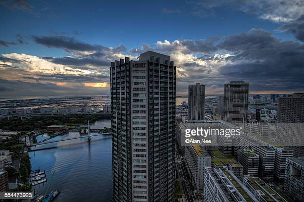 tall building by the river - nee nee stock photos and pictures