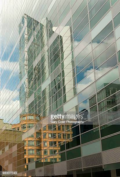 tall building reflections in glass - gary colet stock pictures, royalty-free photos & images