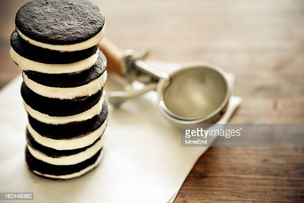 Tall ice cream sandwich with ice cream scoop