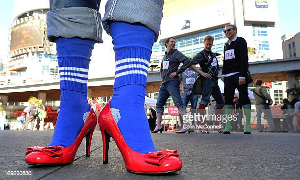 A tall order to walk a mile in these Groups of men stepped out of their shoes and put on high heels today thursday Sept 27th and took over part of...
