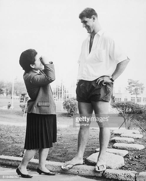 Tall Order Tokyo Japan Appearing diminutive a Japanese girl has to look up to giant athlete Anton Geesink to get his picture The young girl who is an...