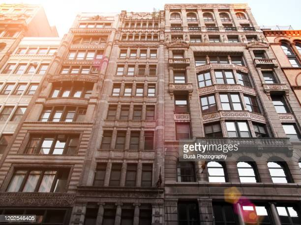 tall pre-war residential and office buildings in soho, manhattan, new york city - soho new york stock pictures, royalty-free photos & images