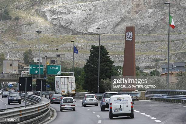 A tall red monument stands in memory of the 500kilogram bomb used in the attack against a motorcade which killed Falcone his wife Francesca Morvillo...