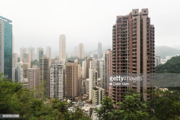 Tall residential buildings in the very densely populated area of Happy Valley in Hong Kon