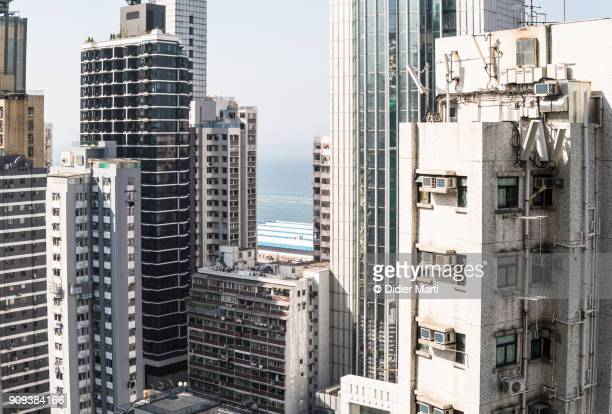 Tall residential buildings in the very densely populated area of Sheung Wan in Hong Kong island