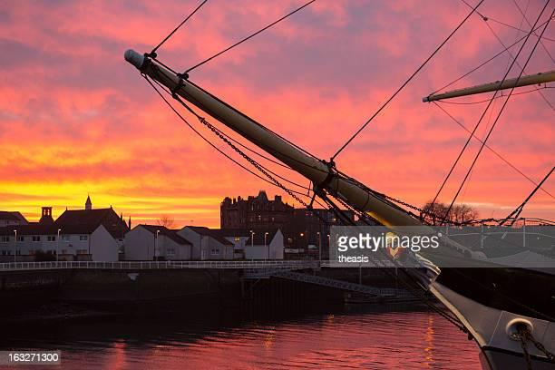 tall ship at sunset - theasis stockfoto's en -beelden
