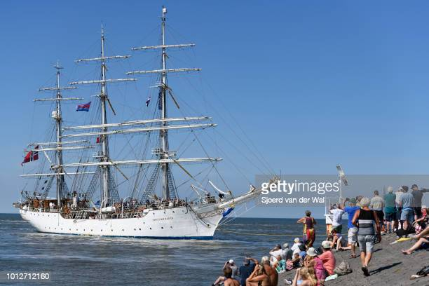 Tall Ship Christian Radich from Norway entering the port of Harlingen during the finish of the 2018 Tall Ship Race on August 3, 2018 in Harlingen,...