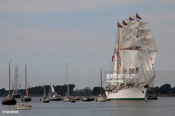 a tall ship escorted by smaller ships on its way to amsterdam - frans sellies stockfoto's en -beelden