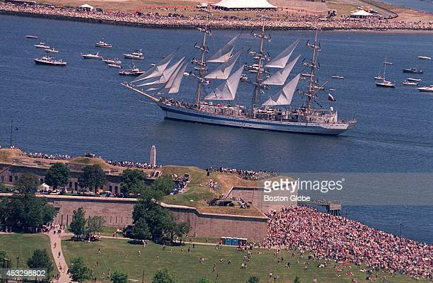 A tall ship passes by Castle Island in South Boston