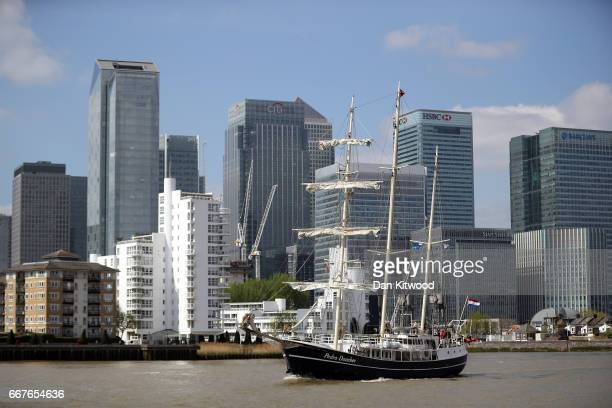 A tall ship sails on the Thames near the Canary Wharf business district on April 12 2017 in Greenwich England Around 30 Tall Ships from around the...
