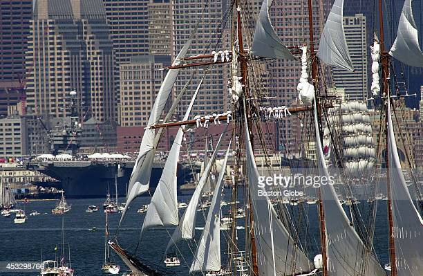 Tall ships arrive in a parade route into Boston Harbor The crew of the Juan Sebastian de Elcano is positioned on the mast of the ship