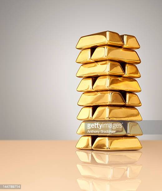 A tall stack of gold ingots