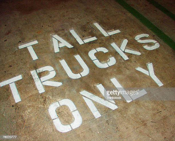 tall trucks only painted on pavement - thinkstock stock photos and pictures