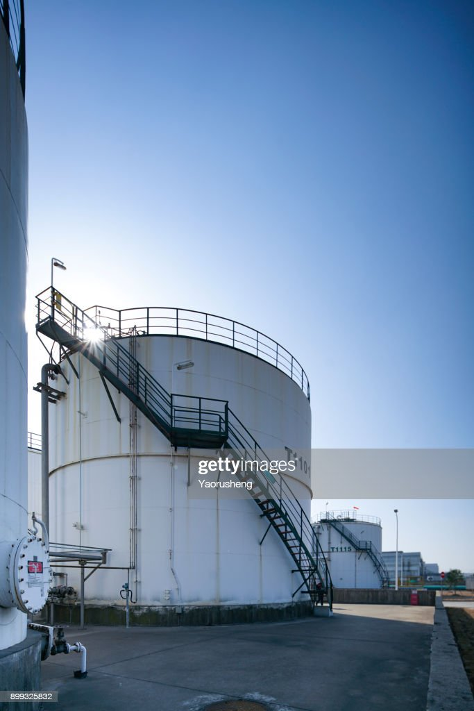 Tall White Oil Storage Tanks Stock Photo - Getty Images