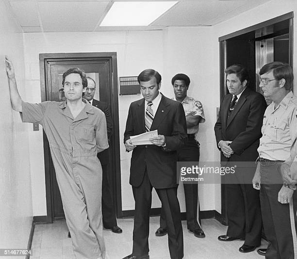 Tallahassee, FL: Suspected murderer Theodore Bundy leans on the Leon County jail wall as an indictment charging him with the murdersof two FSU coeds...