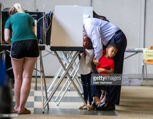 Tallahassee mayor and Democratic gubernatorial candidate Andrew Gillum casts his ballot with his fouryearold twins Caroline left and Jackson on...