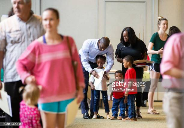 Tallahassee mayor and Democratic gubernatorial candidate Andrew Gillum shows his ballot to his fouryearold daughter Caroline while her twin brother...