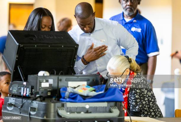 Tallahassee mayor and Democratic gubernatorial candidate Andrew Gillum puts on his I Voted sticker after casting his ballot on Election Day on...