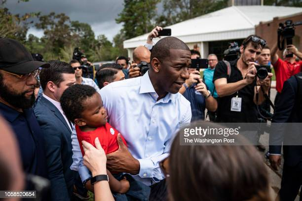 Tallahassee Mayor and Democratic nominee for Governor of Florida Andrew Gillum with his family by his side greets supporters after voting for himself...