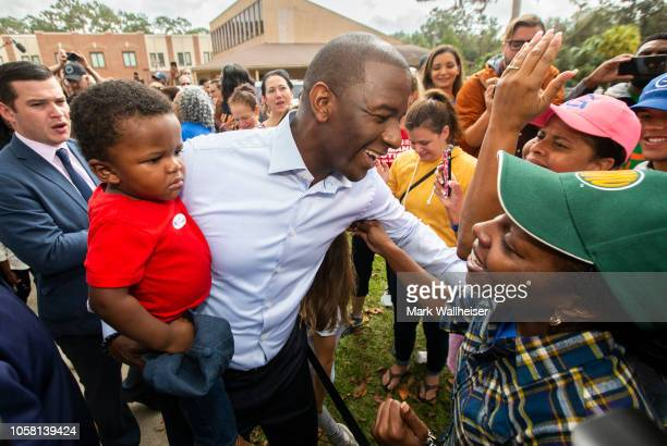 Tallahassee mayor and Florida Democratic gubernatorial candidate Andrew Gillum with is one year old son Davis hugs supporters after casting his...