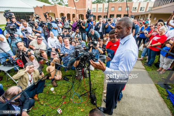 Tallahassee mayor and Florida Democratic gubernatorial candidate Andrew Gillum with is one year old son Davis talks with the media after casting his...