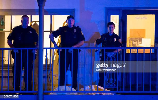 Tallahassee Police officers are stationed outside the HotYoga Studio after a gunman killed one person and injured several others inside on November 2...