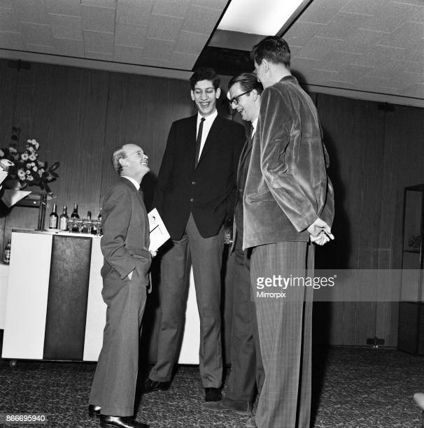 Tallest Man Competition held at the Londoner Hotel Welbeck Street London A J Trevor looks like a dwarf talking to three of the contestants winner...