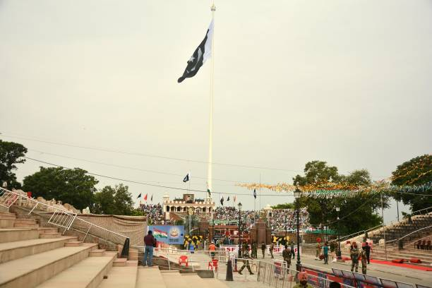 Tallest National flag of Pakistan fluttering at Wagah Border on August 14 2017 near Amritsar India