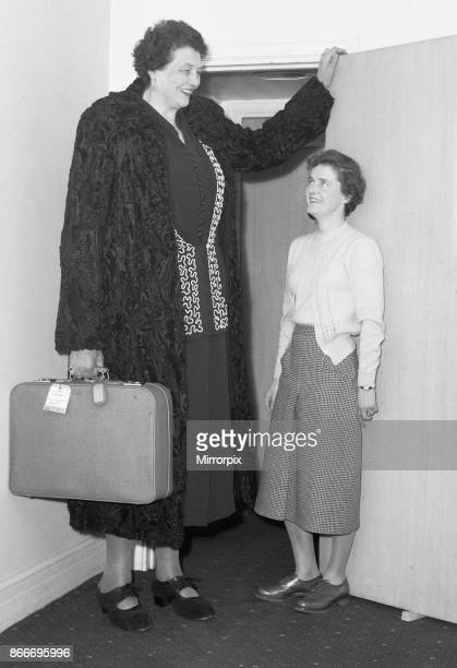Tallest woman in the world Katja Van Dyk 8 foot 4 and a half inch tall and wighs 32 stone checking into her London hotel 2nd March 1954