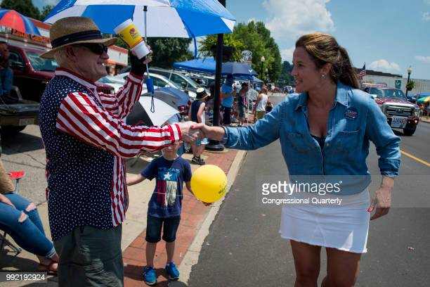 Talley Sergent who is campaigning to be elected as a House Representative for West Virginia greets the crowd during the Ripley 4th of July Grand...