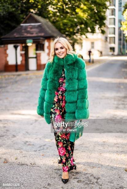 Tallia Storm wearing Dolce Gabbana outfit Louboutin shoes and Hasnium faux fur jacket on September 13 2017 in London England