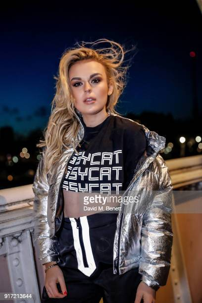 Tallia Storm wearing Dolls Kill trousers top and jacket with Christian Louboutin shoes on February 11 2018 in London England