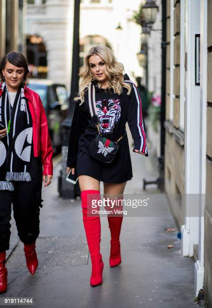Tallia Storm wearing Gucci bag red overknees boots seen outside Mulberry during London Fashion Week February 2018 on February 16 2018 in London...