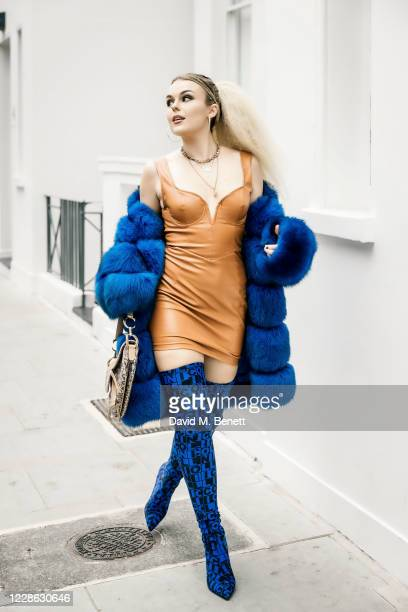 Tallia Storm wearing Pretty Little Thing Dress, Hafnium Copenhagen Fur, Dior handbag and Collini Milano Boots in Kensington on September 9, 2020 in...