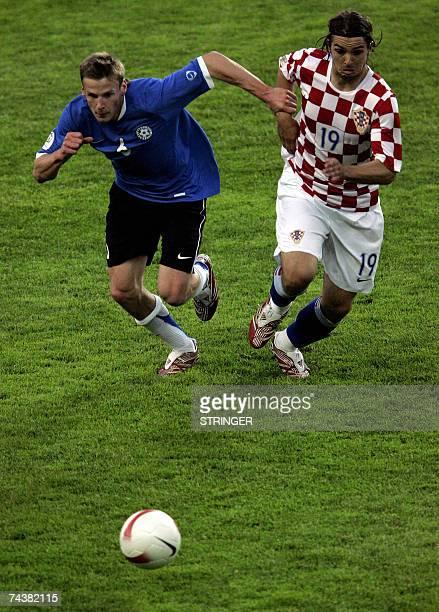 Croatia's Niko Kranjacar fights for the ball against Estonia's Aleksandr Dmitrijev during their Euro 2008 Group E qualifying soccer match in Tallinn,...