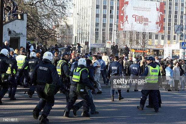 Police arrest 27 April 2007 some of hundreds Russians protesting in Tallinn after the removal of a Soviet war memorial Nearly 100 people were injured...